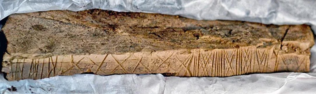 Incised decorated stone