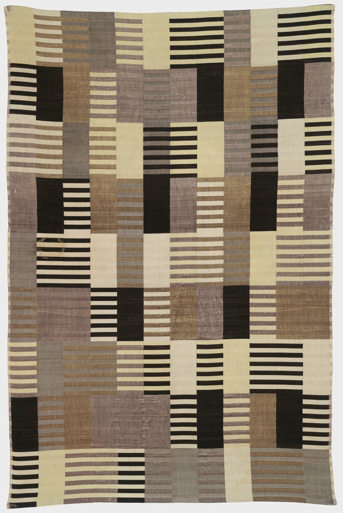 Wall hanging in shades of black brown and yellow