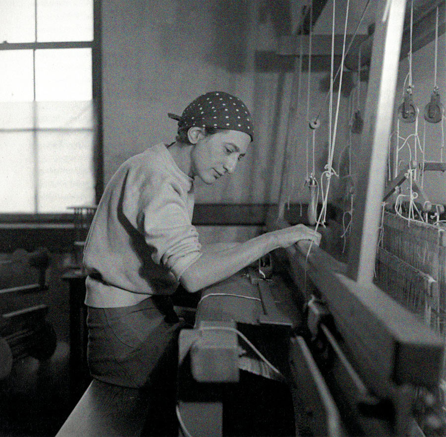 Anni Albers weaving at her loom