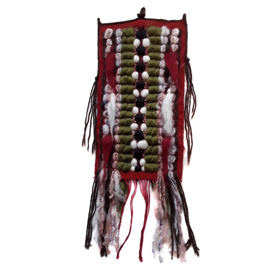 Woven wall hanging by Chris Leighton in red, green and white with fringes