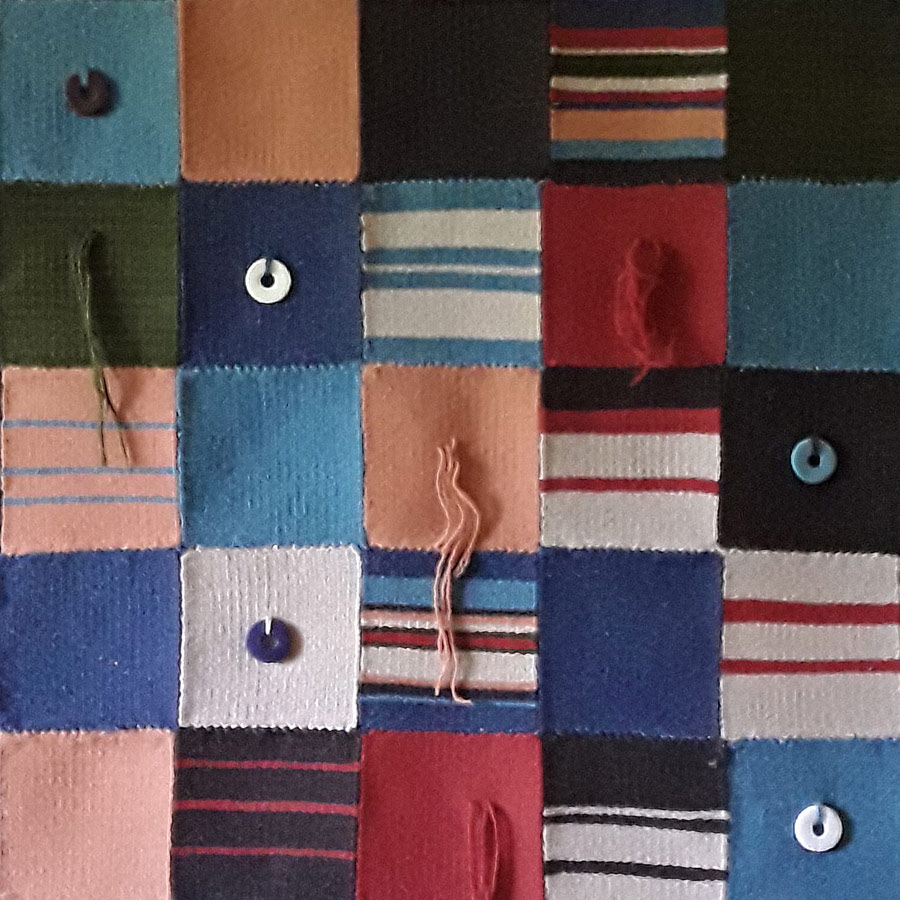 Detail of woven wall hanging by Chris Leighton - patchwork style in multiple colours with buttons and hanging threads