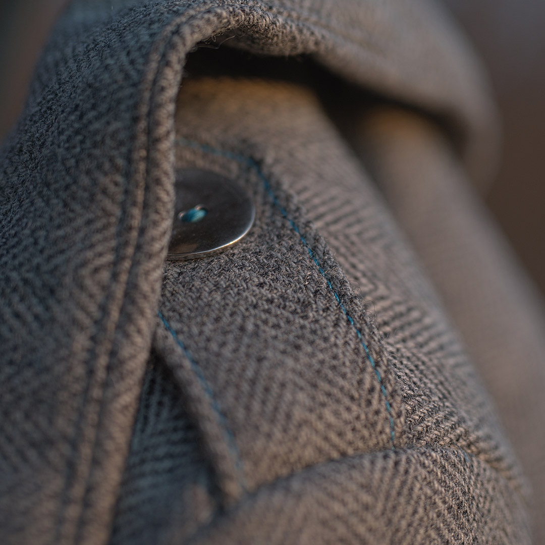 Detail of tweed coat shoulder