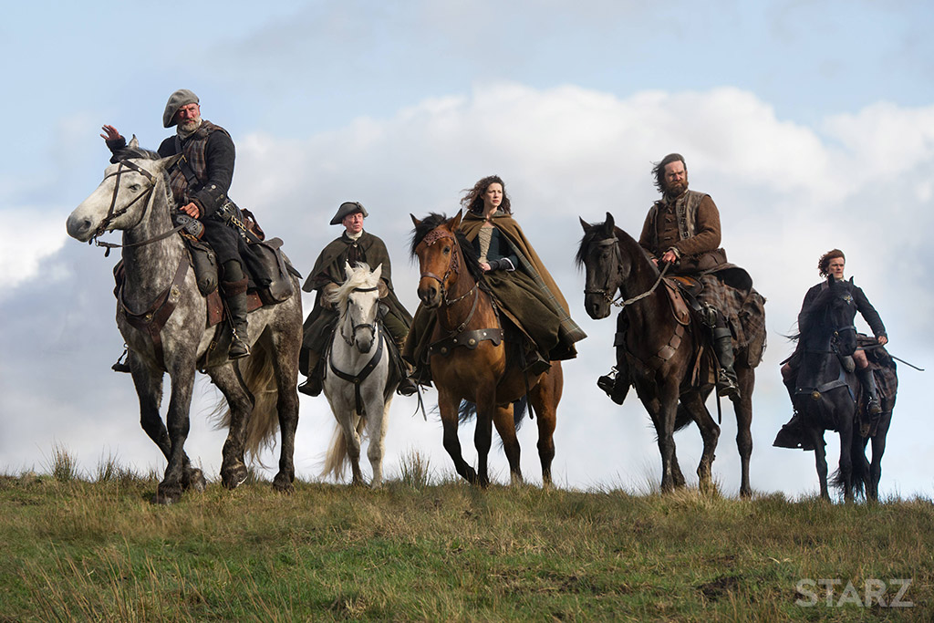 Still from Outlander - people on horseback