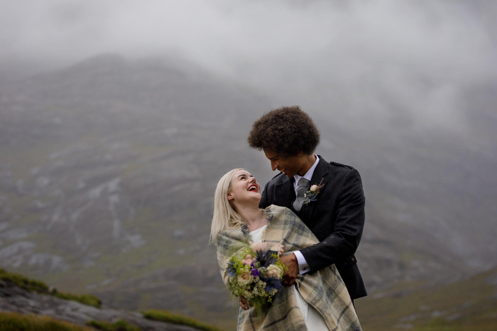 Wedding couple in misty landscape