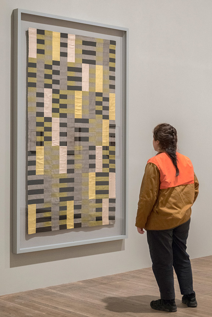 anni albers exhibition visitor looking at wallhanging