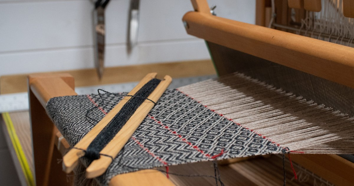 sample loom with pointed twill design