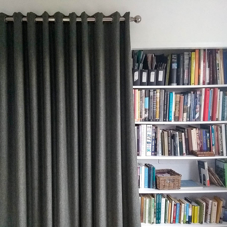tweed curtains and bookshelf