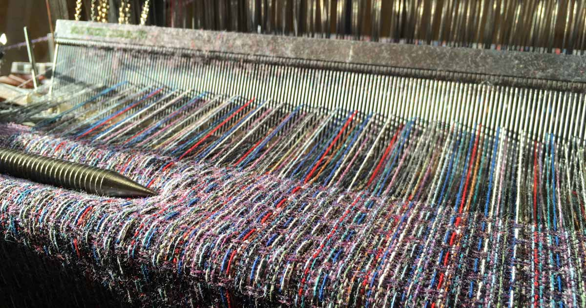 multicoloured shawls on the loom