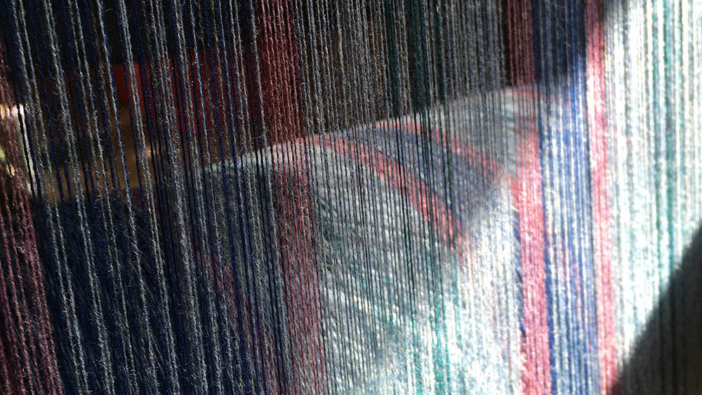 Light on woven cloth on loom