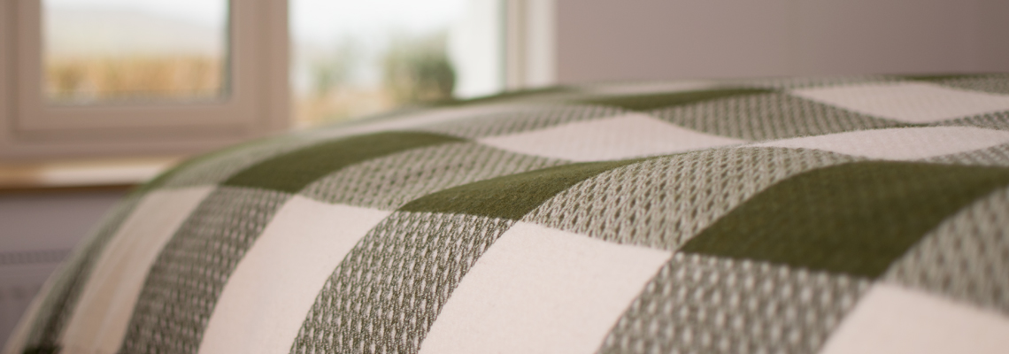 skye-weavers-glendale-wool-throws-sea-lettuce-window-view