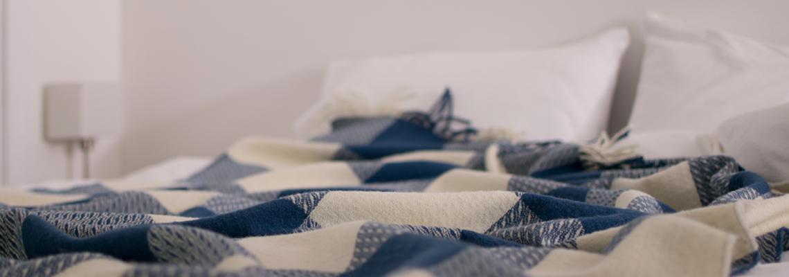 skye-weavers-glendale-wool-throws-white-horses-bedroom