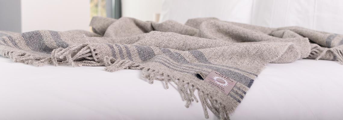 skye-weavers-skye-wool-throw-grey-stripes-on-bed