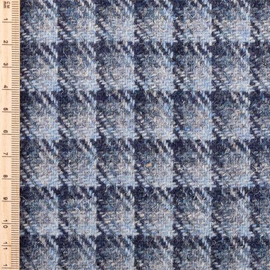 Close up of blue checked tweed