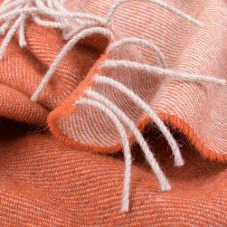 detail of orange woollen throw