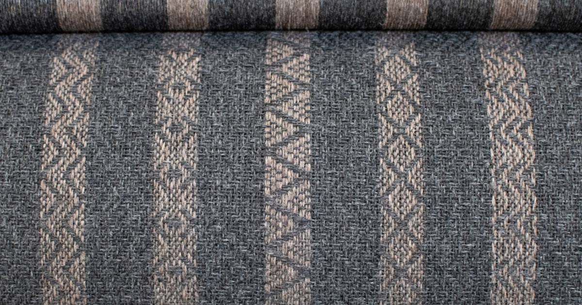 detail of grey striped weave on loom