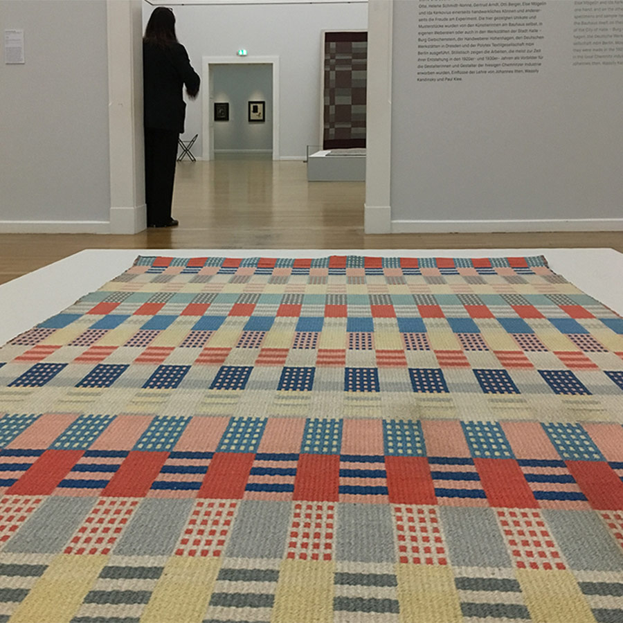 View of geometric rug in exhibition