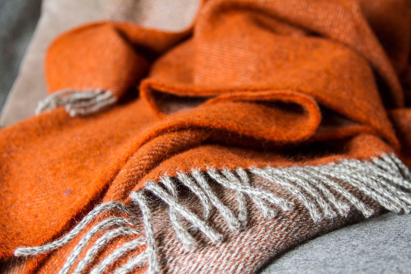 Skye Weavers Two Sided Wool Throw In Burnt Orange