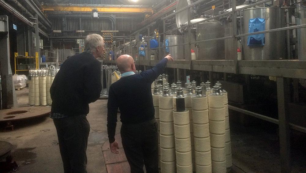 Two men in dye factory