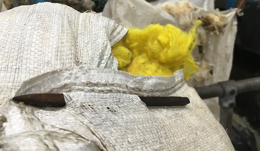 Yellow wool in bag